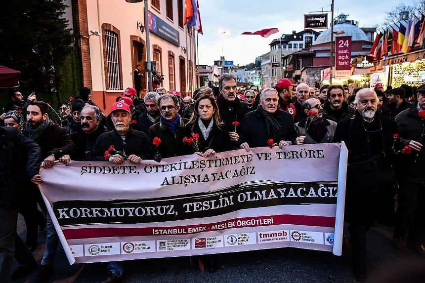 "Turkish union members marching with a banner that reads, ""We will not get used to terrorism"", in Istanbul on Tuesday. Sunday's shooting followed a year of attacks in Turkey, in which hundreds of people were killed."