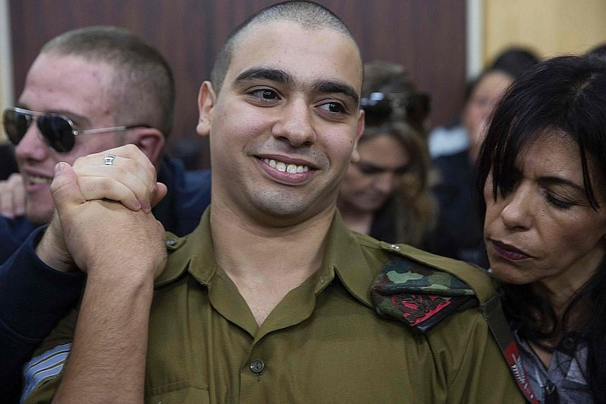 Azaria awaiting his verdict in a military court yesterday. The soldier has been on trial for manslaughter since May, with right-wing politicians defending him despite top army brass harshly condemning the killing.