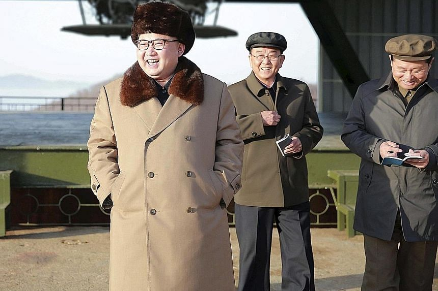 North Korean leader Kim Jong Un (far left) visiting Sohae Space Centre in Cholsan County, North Pyongan province, for the testing of an intercontinental ballistic missile engine.