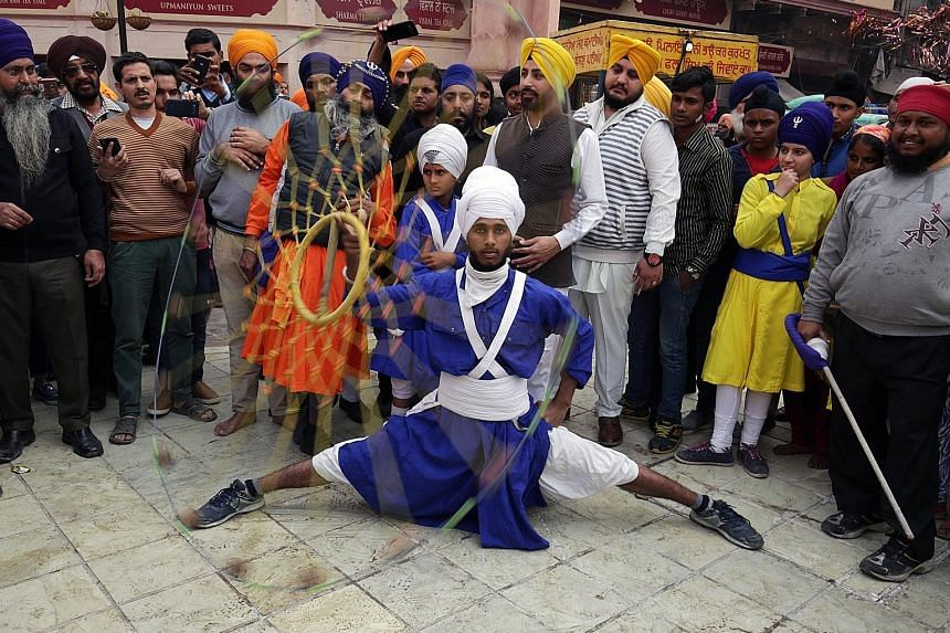 A man performing the Sikh martial art form of Gatka. He was taking part in a religious procession in Amritsar yesterday that marked the 350th anniversary of the birth of the 10th Sikh Guru, Sri Guru Gobind Singh, who initiated the sect of Khalsa Pant