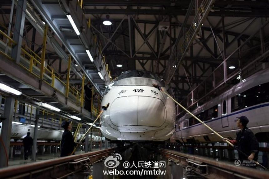 A high-speed train being cleaned after it turned grey due to severe smog in several cities in China.