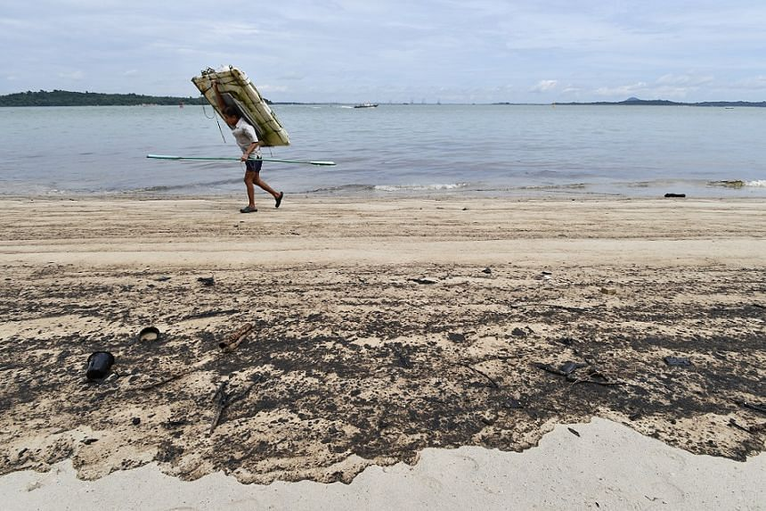 The oil stains left by the oil spill on the sand at Changi Beach on Jan 5, 2017.