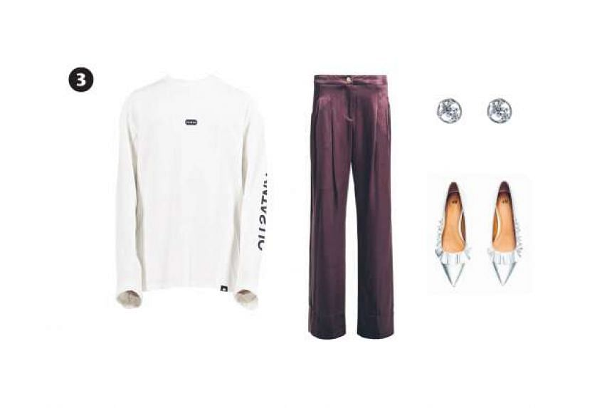 """3. Heich Blade """"Fantastic"""" long-sleeve T-shirt, $130, from www.bangcube.com; dark red satin trousers, $170 (usual price $340), from Bimba Y Lola; silver court shoes, $39.90, from H&M; and Starry Night earrings with cut-out detail, $100,from Risis"""