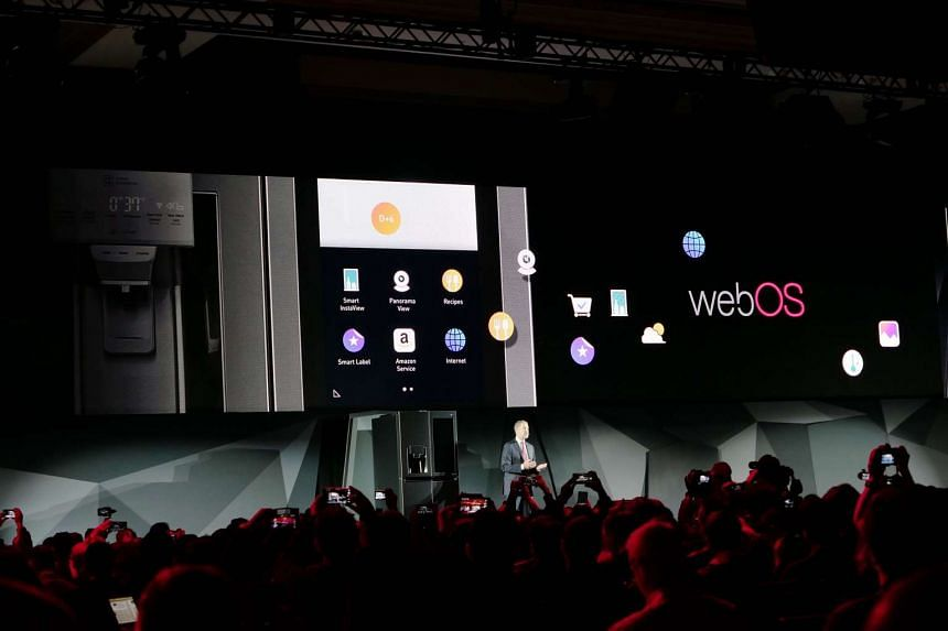 David VanderWaal, LG Electronics USA's vice-president of marketing, unveiling the Amazon Alexa-powered LG Smart InstaView Door-in-Door refrigerator during a press conference before CES 2017.