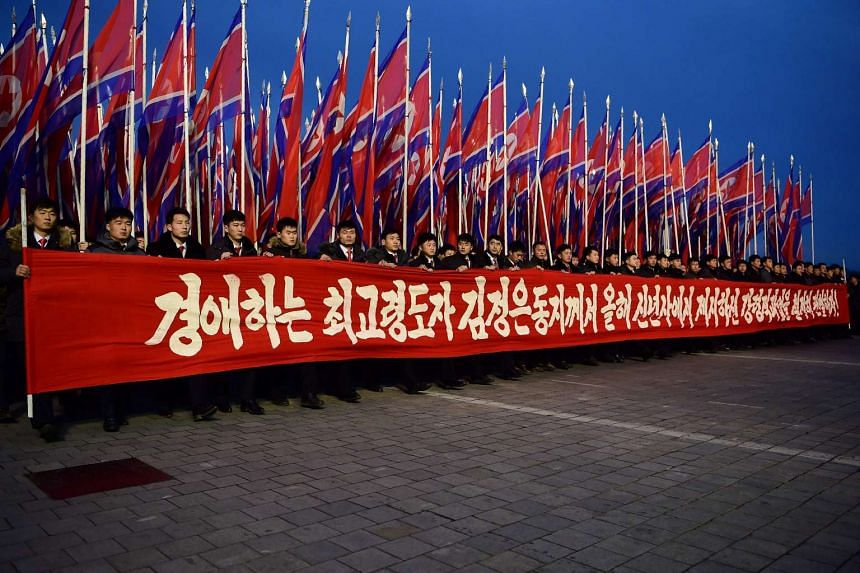 Participants march during a procession following a mass rally in Pyongyang on Jan 5, 2017, in honour of tasks set forth by North Korean leader Kim Jong Un.