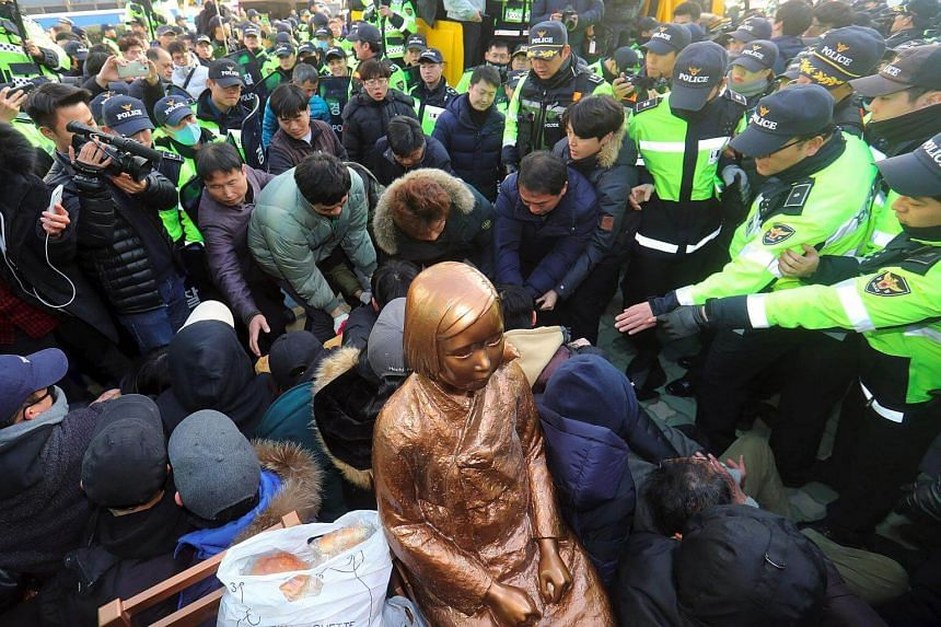 South Korean activists staging a sit-in protest on Dec 28, 2016, to prevent government employees from seizing a statue symbolising victims of Japanese war-time sex slavery. The authorities later allowed activists to place the statue outside the Japan