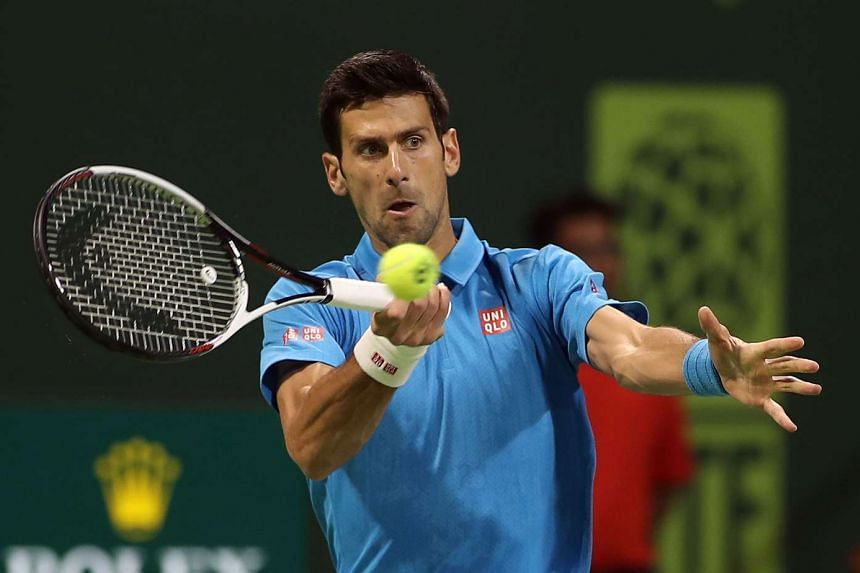 Serbia's Novak Djokovic returns the ball to Jan-Lennard Struff of Germany, during the ATP Qatar Open tennis competition in Doha on Jan 2, 2017.