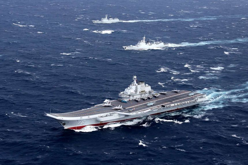 File photo of China's Liaoning aircraft carrier with accompanying fleet conducting a drill in an area of the South China Sea.