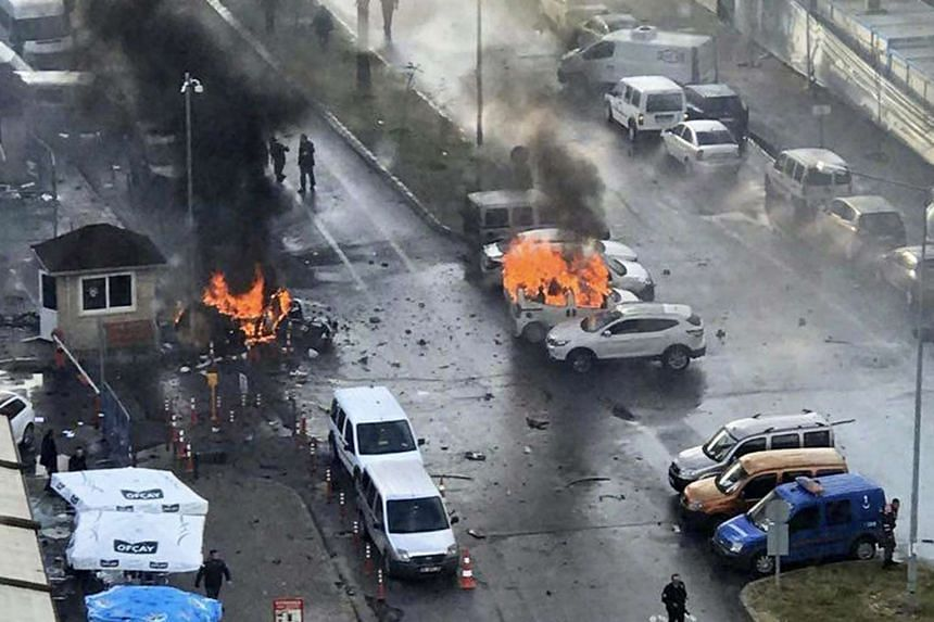 Cars burn after explosion while police try to help injured people near courthouse in Izmir, Turkey, on Jan 5, 2017.