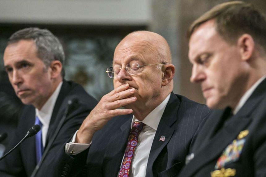 (From left) Undersecretary of defence for intelligence Marcel Lettre, director of national intelligence James Clapper  and National Security Agency director Michael Rogers said they stood by the intelligence community's Oct 7 finding that Russia inte
