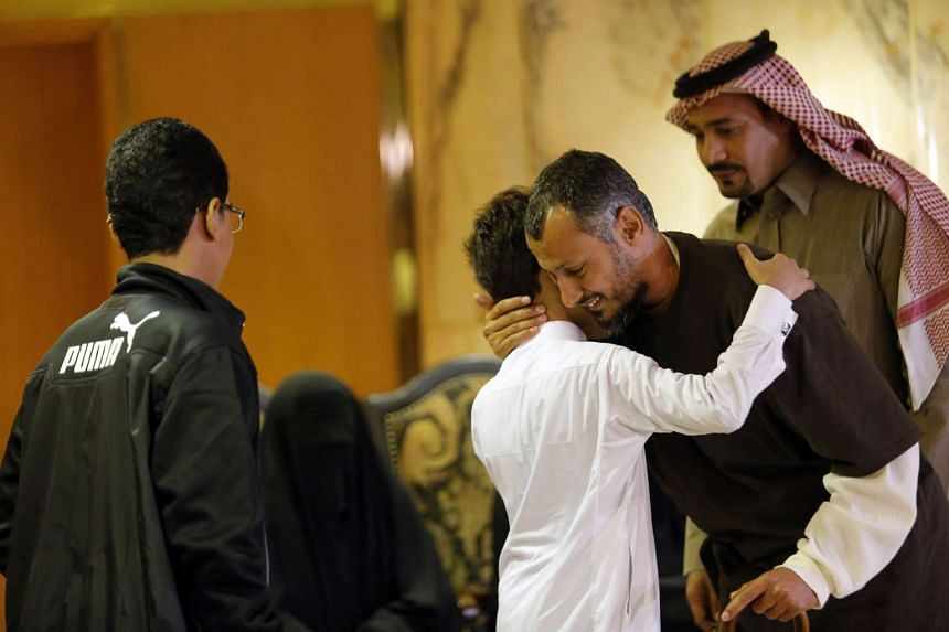A former Yemeni inmate, released from the US military prison in Guantanamo Bay, is welcomed by his family upon his arrival in Riyadh on Jan 5, 2017.