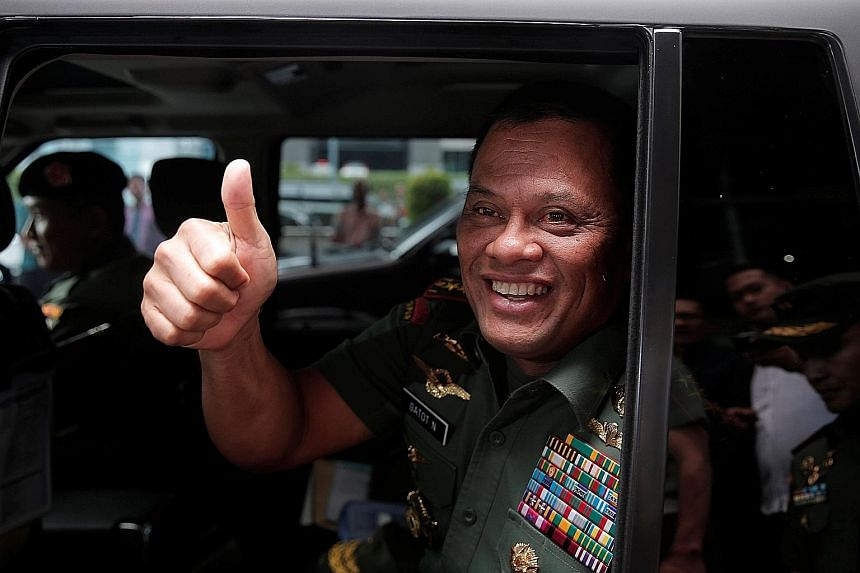 """TNI chief Gatot (right) told reporters yesterday that a TNI officer saw teaching materials at Campbell Barracks that apparently """"disparaged"""" the TNI and Indonesians."""