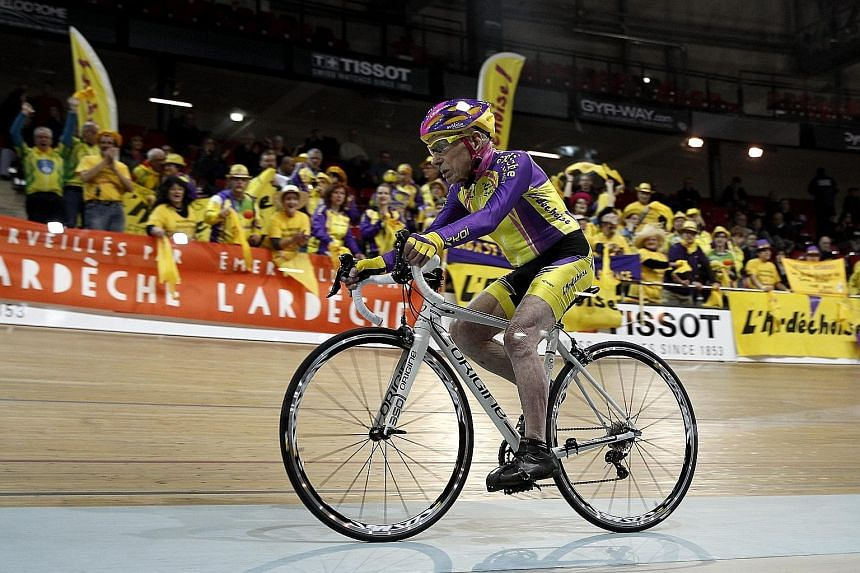 French cycling enthusiast Robert Marchand, 105, covering 22.528km in an hour at a velodrome in Saint-Quentin-en-Yvelines, near Paris.