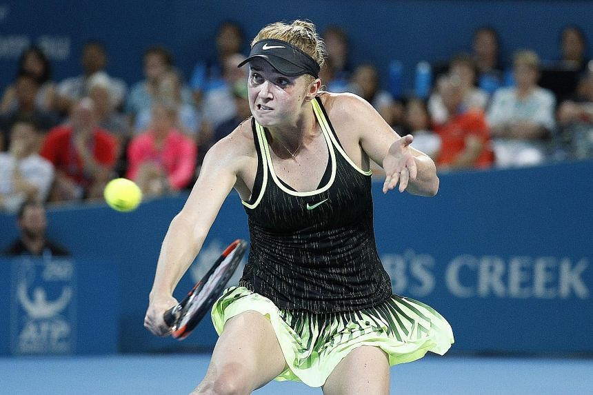 Elina Svitolina making a backhand return to Angelique Kerber in their quarter-final in Brisbane. The Ukrainian took out the two-time Grand Slam champion in three sets.