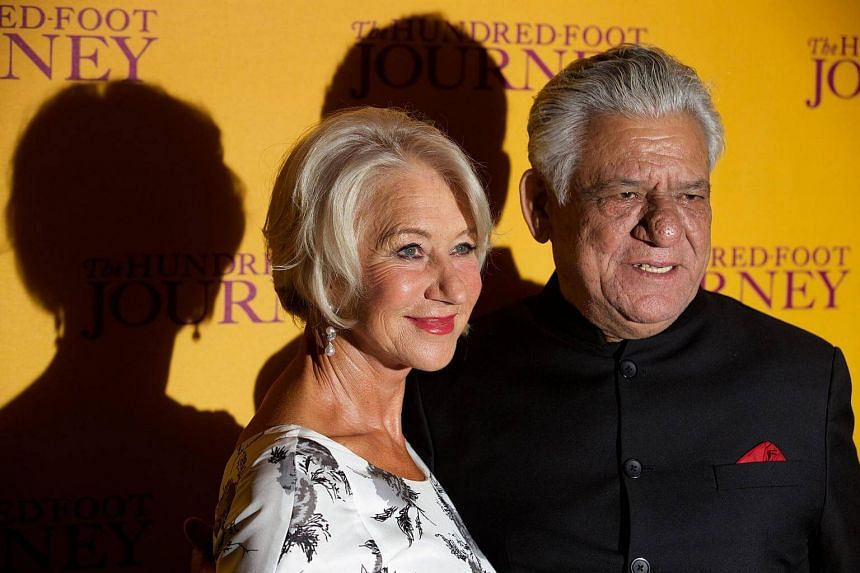 British actress Helen Mirren (left) and Indian actor Om Puri (right) arriving for the Gala Screening of The Hundred-Foot Journey at the Curzon Mayfair in London, Britain, on Sept 3, 2014.
