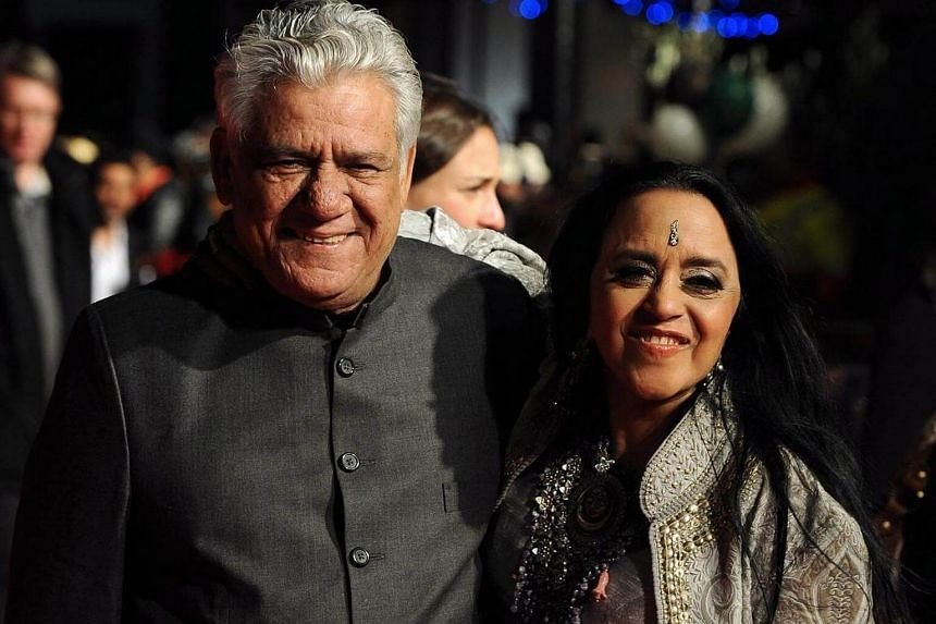 Cast members, Indian actor Om Puri (left) and Indian actress Ila Arun (right), arriving at the premiere of British director Andy de Emmony's movie West Is West during the 54th British Film Institute (BFI) London Film Festival held at the Vue West End
