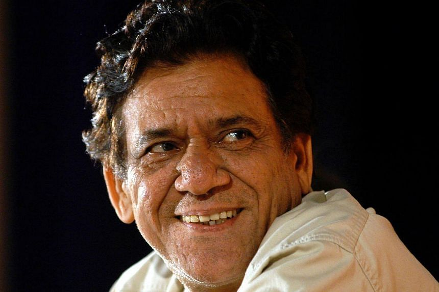 Indian actor Om Puri smiling during his felicitation ceremony organised by the Rotary Club of Mumbai, in Bombay, on Aug 15, 2004.