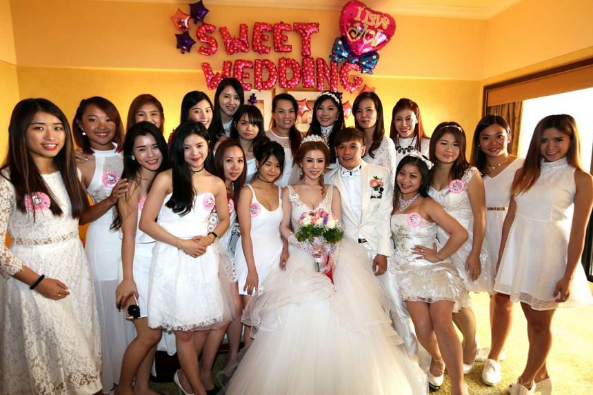 Mrs Tan with her 21 bridesmaids.