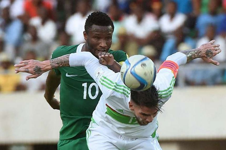 Nigeria midfielder John Obi Mikel (in green) during the 2018 FIFA World Cup African zone group B qualifying football match between Nigeria and Algeria on Nov 12, 2016. Mikel has become the latest big-name player to join the Chinese Super League gold