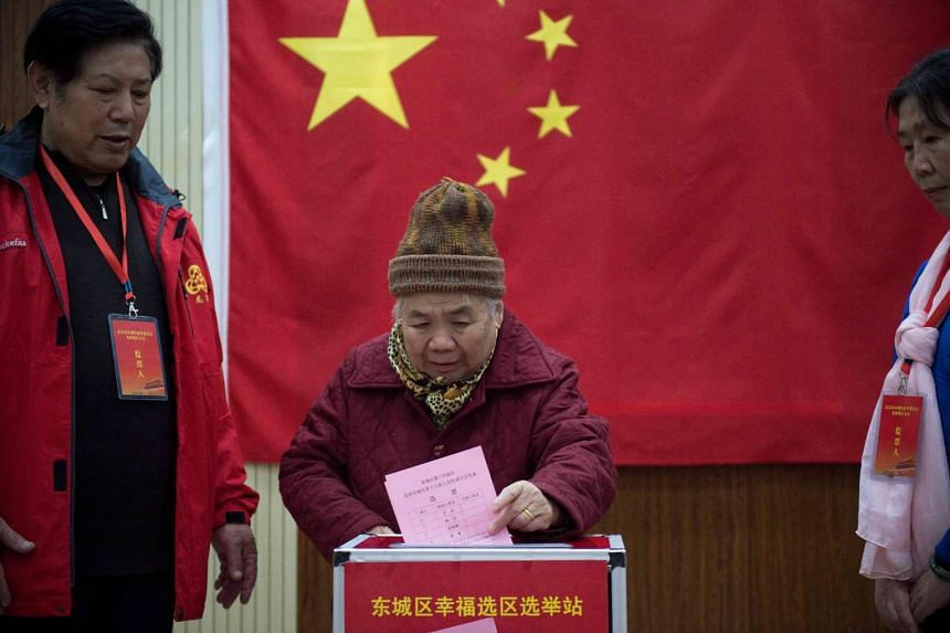 File photo of an elderly woman voting at a polling station in Beijing on Nov 15, 2016. China has vowed to give no quarter in handling election fraud in the upcoming central Communist Party Congress.
