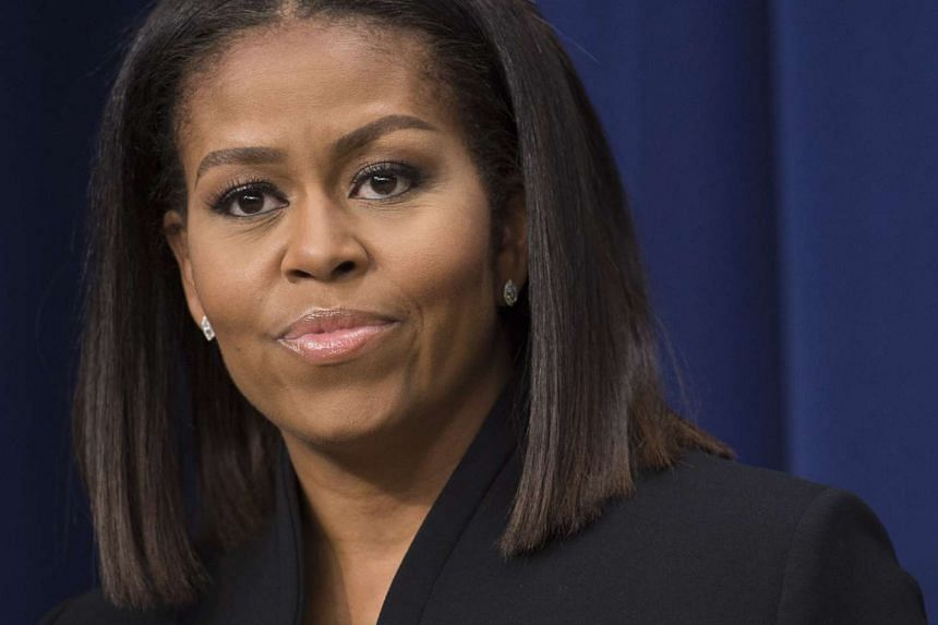 """US First Lady Michelle Obama speaks following a screening of the movie, """"Hidden Figures,"""" in the Eisenhower Executive Office Building adjacent to the White House in Washington, DC on Dec 15, 2016."""