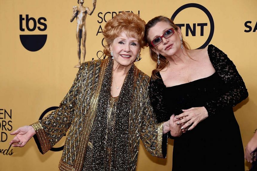 Debbie Reynolds (left) and her daughter, Carrie Fisher, at the 21st Annual Screen Actors Guild Awards in Los Angeles, California, on Jan 25, 2015. Fisher, 60, died on Dec 27, while Reynolds suffered a stroke a day later and died at the age of 84.