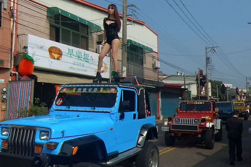 Fifty pole dancers gave a Taiwanese politician a raucous final send-off in an eyebrow-raising funeral parade that jammed traffic and drew crowds of onlookers.