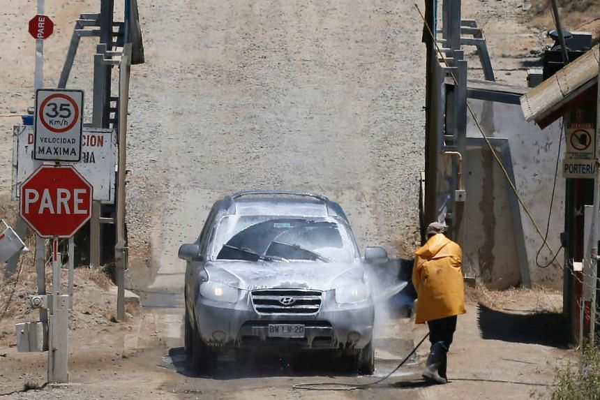 A worker spraying disinfectant on a vehicle at the entrance of a turkey processing plant in Quilpue city, Chile, on Jan 5, 2017.