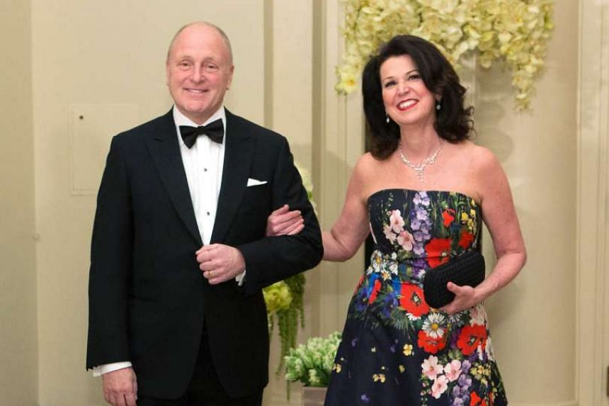 This file photo taken on March 10, 2016 shows US Ambassador to Canada Bruce Heyman and Vicki Heyman arriving at a State Dinner in honor of Canadian Prime Minister Justin Trudeau at the White House in Washington,DC.
