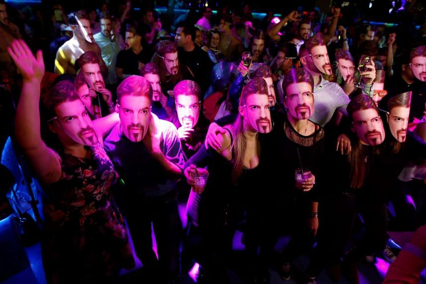 Fans of the late George Michael wearing masks at a tribute night event, in London, on Jan 6, 2017.