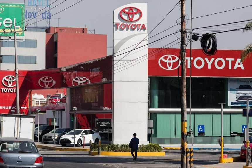 A pedestrian walking past a Toyota car dealership in Mexico City on Jan 6, 2017. US President-elect Donald Trump has threatened to impose punitive tariffs on the automotive manufacturer's cars built in Mexico.
