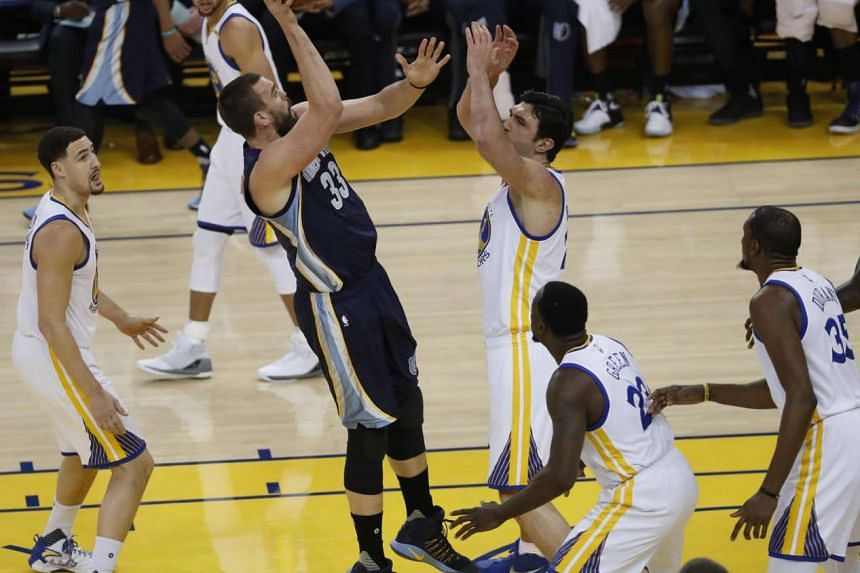 Memphis Grizzlies center Marc Gasol (with ball) helped his team dominate the overtime period 17-8 as the Grizzlies shocked the NBA-leading Golden State Warriors 128-119 on Jan 6, 2017.