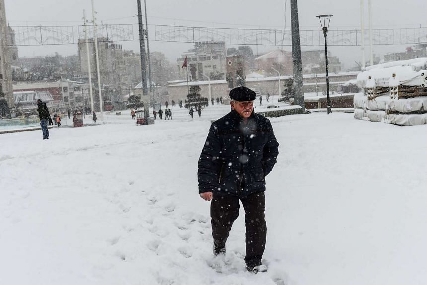 A man walks in the snow at Taksim Square in Istanbul, Turkey, on Jan 7, 2017, following a heavy snowstorm.