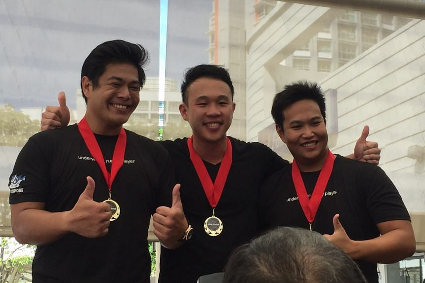 Winners of Food League Singapore's first official event under the amateurs category: (from left) Stanley Ng, 31, Zach Lee, 31, and Joel Chan, 30. They were given 20 spicy wings.