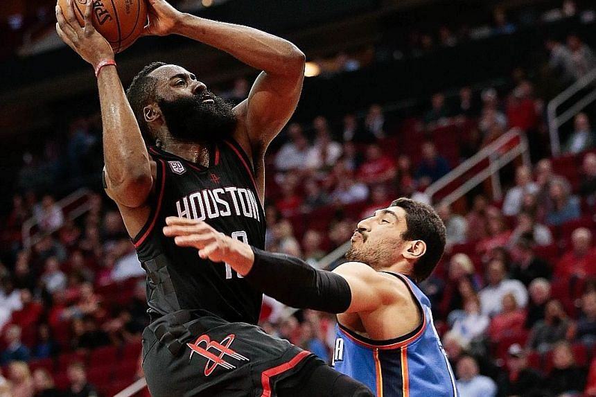 James Harden is fouled by Oklahoma's Enes Kanter as he drives to the basket at Toyota Centre. The Houston guard posted 26 points, 12 assists and eight rebounds - just missing out on a fourth straight triple double.