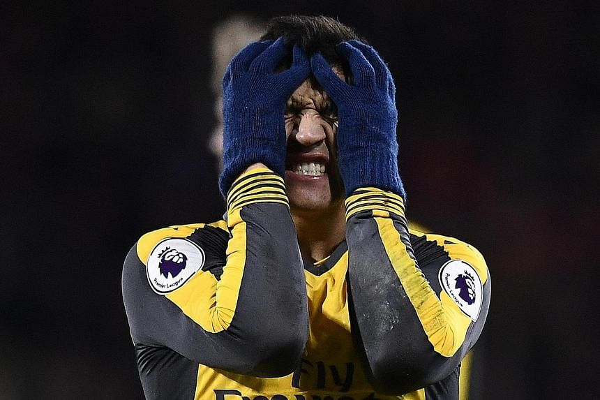 """Alexis Sanchez showing his frustration despite helping Arsenal come from 0-3 down to draw 3-3 at Bournemouth in midweek. Manager Arsene Wenger says the Chilean striker is """"mentally and physically jaded"""", so he will not feature at Preston today."""
