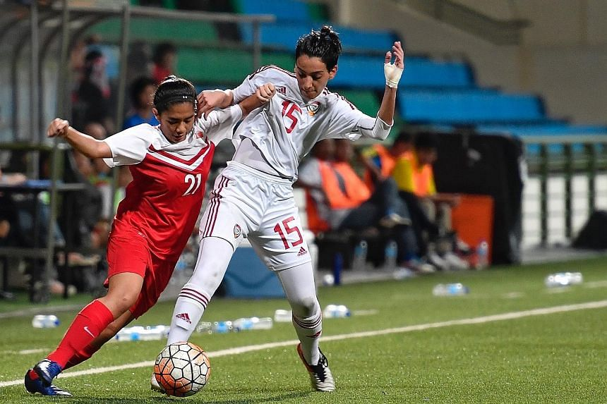 Singapore's Stephanie Dominguez (left) vying for the ball with the United Arab Emirates' Afra Almheiri in a 0-0 friendly draw at Jalan Besar Stadium last night.
