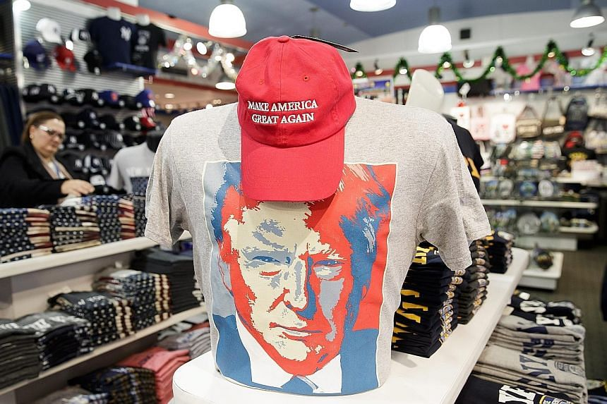 Above: A ticket for the US presidential inauguration ceremonies on Jan 20. Russian officials allegedly celebrated Mr Trump's victory in last year's election. Left: A T-shirt with an image of US President-elect Trump on display at a tourist shop in Ne