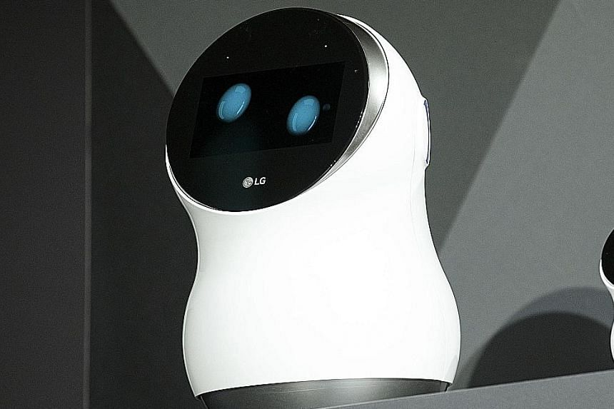LG's Hub Robot, a digital assistant powered by Amazon's Alexa software, can answer questions and make orders online. Bosch's board of management member Werner Struth introducing Kuri, a home robot assistant developed by the company's subsidiary Mayfi