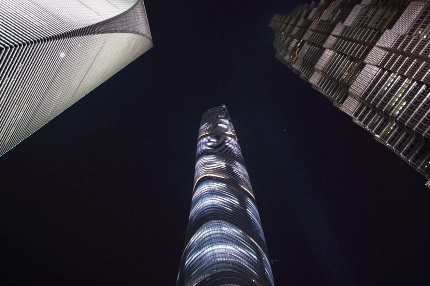 The lifts in Shanghai Tower (centre), made by Japanese firm Mitsubishi Electric, are the fastest in the world.