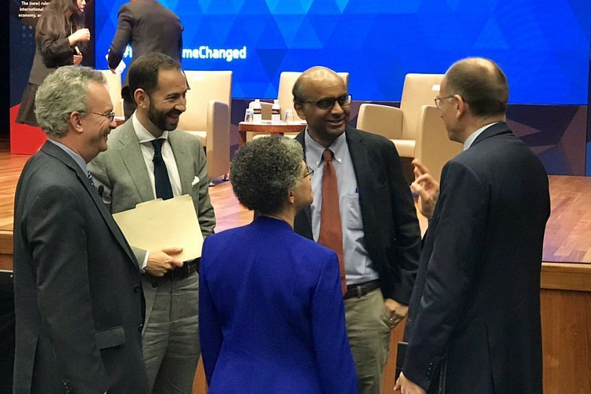 Singapore Deputy Prime Minister Tharman Shanmugaratnam (second from right) with several leading international affairs experts on the last day (Jan 7) of a three-day conference hosted by the Lee Kuan Yew School of Public Policy