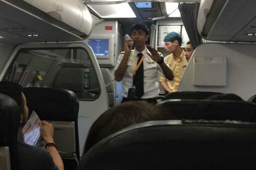 "Mr Lam, a passenger on the affected flight, praised the crew especially the pilot (pictured) for their ""cool and calm handling of the situation""."