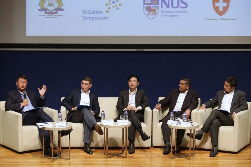 Members of the panel (from left) Dr Tan Chi Chiu, chairman of the Lien Centre for Social Innovation; Mr Warren Fernandez, The Straits Times' editor and editor-in-chief of Singapore Press Holdings' English, Malay, Tamil Media Group; Mr Lawrence Wong,