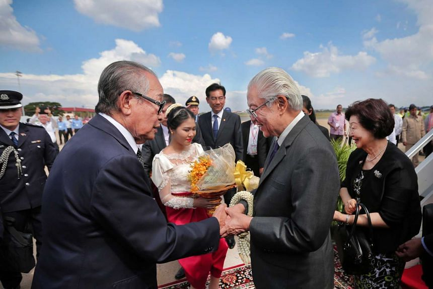 President Tony Tan is greeted by Cambodia's Deputy Prime Minister and Minister of the Royal Palace Kong Sam Ol upon his arrival at Phnom Penh on Jan 8, 2017.