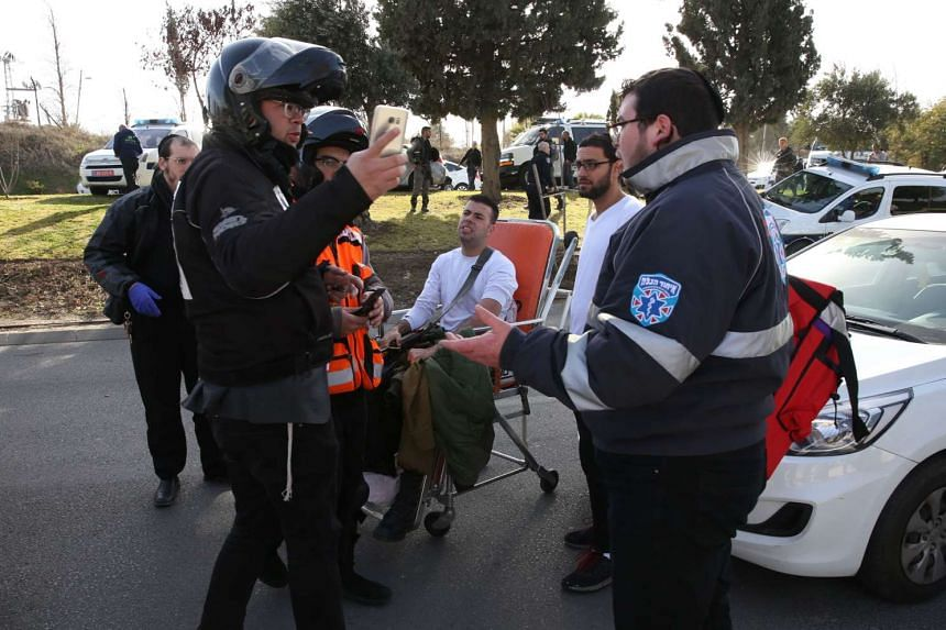 Israeli security forces and medics help evacuate a wounded soldier at the site of a ramming attack in Jerusalem on Jan 8, 2017.