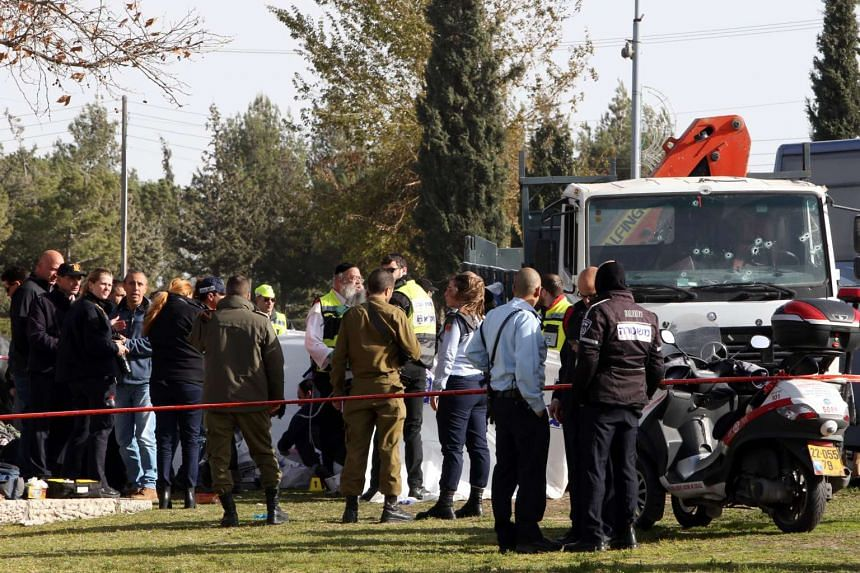 Israeli security forces and medics gather at the site of a ramming attack in Jerusalem on Jan 8, 2017.