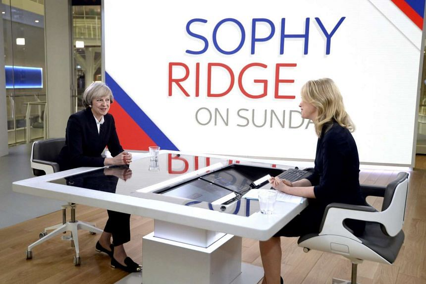 Britain's Prime Minister Theresa May (left) is interviewed by Sophy Ridge on Sky News, during the Ridge on Sunday programme, in London on Jan 8, 2017.