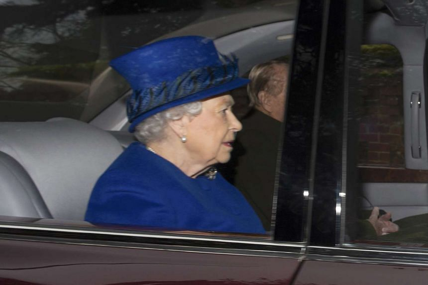 Britain's Queen Elizabeth II and her husband Prince Philip (partially hidden) arriving at St Mary Magdalene Church in Sandringham on Jan 8, 2017.