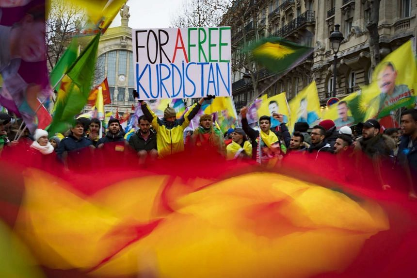 Members of the Kurdish community take part in a demonstration marking the fourth anniversary of the killing of three Kurdistan Workers Party (PKK) members in Paris, France, on Jan 7, 2017.