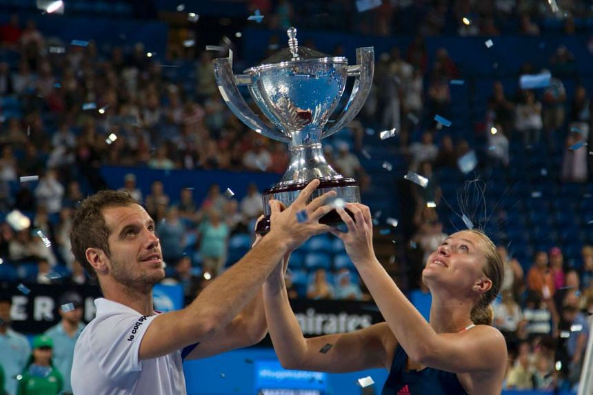 Richard Gasquet (left) )and Kristina Mladenovic of France celebrate with their trophy after defeating Coco Vandeweghe and Jack Sock of the US in the mixed doubles final on day seven of the Hopman Cup tennis tournament in Perth on Jan 7, 2017.